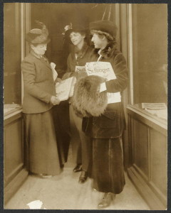 Rep. Jeanette Rankin of Montana, right with muff, reading The Suffragist (1917)